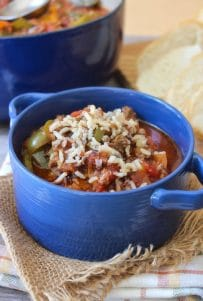 Stuffed Pepper Soup is one of those recipes that, if you love Stuffed Peppers, you will be thrilled with this easy-to-make, flavorful and hearty soup. This Stuffed Pepper Soup is made with organic ingredients such as green and yellow sweet bell peppers, mild Italian sweet sausage, lean ground beef, tomatoes, garlic, onions, a delicious broth,  and a wild rice blend all cooked to perfection in a rich broth.