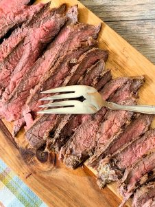 Flank Steak With Chimichurri is one of those deliciously flavorful yet economical recipes that's you'll love all year round. Marinated in a mojo until tender and juicy, then seasoned, grilled, and topped with fresh homemade authentic Chimichurri sauce.