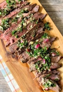 Flank Steak With Chimichurri is a deliciously flavorful yet economical recipe that you'll love all year round. Marinated in a mojo, then seasoned, grilled, and topped with Chimichurri
