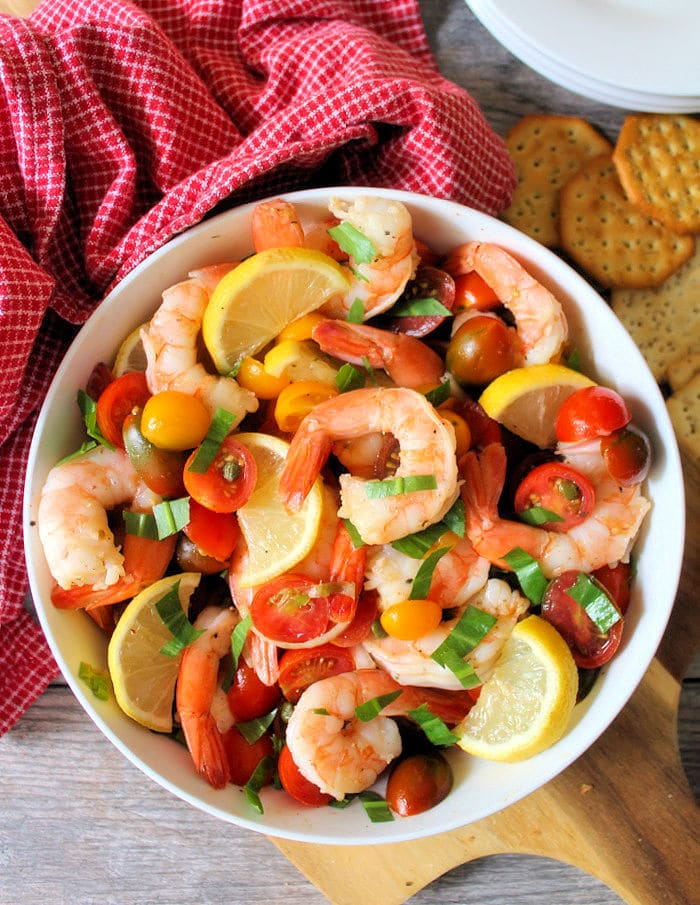 You will love this winning combination of fresh wild-caught jumbo shrimp, a medley of colorful organic grape tomatoes, shallots, Spanish capers, tossed in a lemon and olive oil vinaigrette, and topped with fresh herbs. This Shrimp and Tomato Salad screams decadent and impressive but is simple to make.
